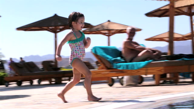 the child jumps into the pool. family holidays in egypt. - sinai egitto video stock e b–roll