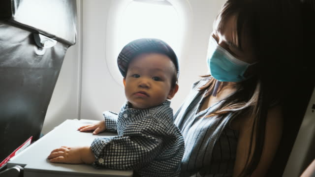 the child was excitedly interested in the plane. - 6 11 months stock videos & royalty-free footage