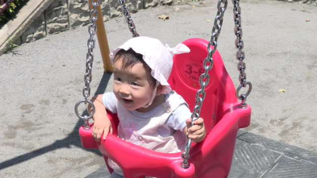 the child who plays in a park - only baby girls stock videos & royalty-free footage