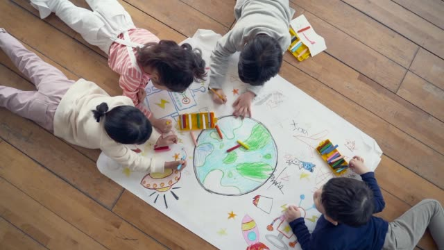 the children draw earth lying down on the floor - crayon stock videos & royalty-free footage