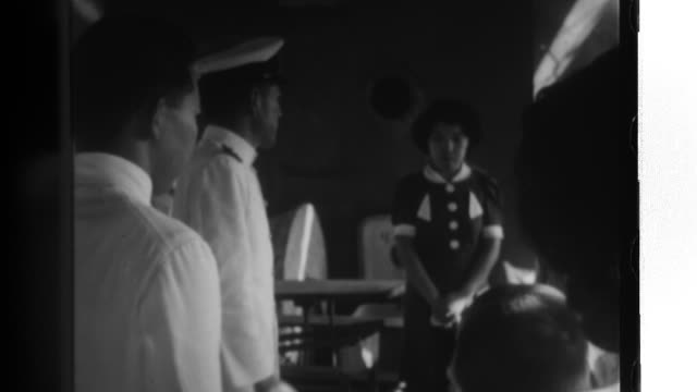the children of japanese residents in bangkok visit a japanese battleship eat the same kind of lunches the sailors eat and watch sailors practicing... - battleship stock videos & royalty-free footage