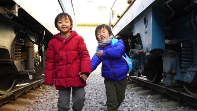 the children play on the track - railway track stock videos & royalty-free footage