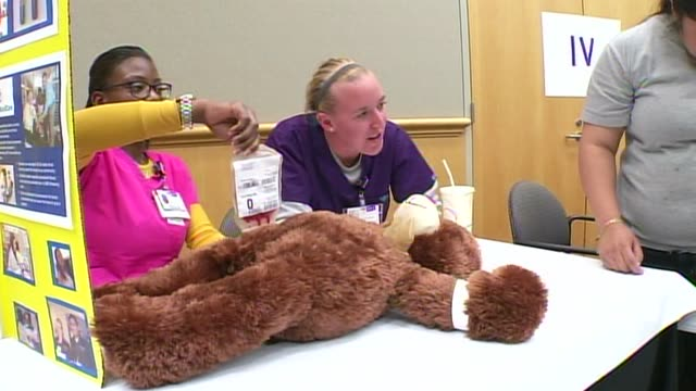 kdaf the children's medical center held a teddy bear clinic to help children understand what goes on in a hospital on march 13 2014 in dallas texas... - scientific imaging technique stock videos & royalty-free footage