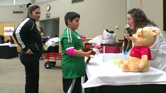 the children's medical center held a teddy bear clinic to help children understand what goes on in a hospital on march 13, 2014 in dallas, texas.... - teddy boy stock videos & royalty-free footage