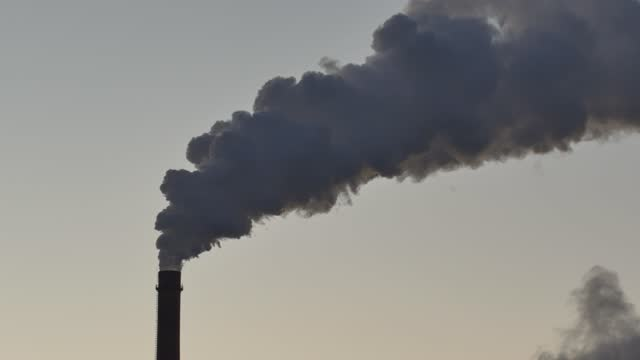 the chimney of the thermal power plant is smoking - coal stock videos & royalty-free footage