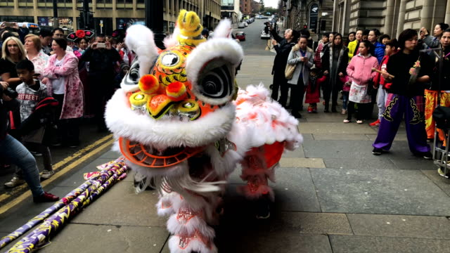 The Chinese community in Glasgow celebrate during Lunar New Year celebrations for the Year of the Dog at George Square on February 18 2018 in Glasgow...