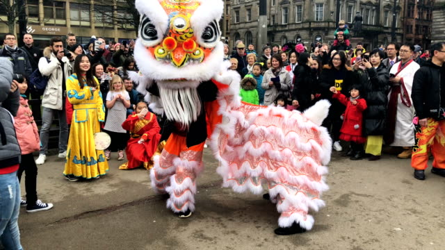 the chinese community in glasgow celebrate during lunar new year celebrations for the year of the dog at george square on february 18 2018 in glasgow... - chinese new year stock videos & royalty-free footage
