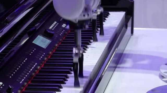 the chinese company zte has two industrial robotic arms in its stand one plays the piano with precision and the other beats the drums both are... - other stock videos and b-roll footage