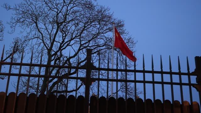 the chinese flag waves behind the gates of the chinese embassy in the french capital on march 24, 2021 in paris, france. france is considering... - politics illustration stock videos & royalty-free footage