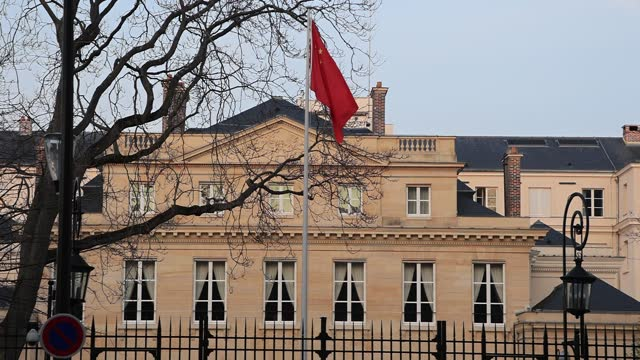 the chinese flag waves in front of the chinese embassy in the french capital on march 24, 2021 in paris, france. france is considering certain... - politics illustration stock videos & royalty-free footage