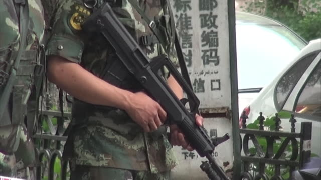 the chinese people's armed police force officers on patrol watching over the street with guns close up shot of the gun tilts up - xinjiang province stock videos & royalty-free footage