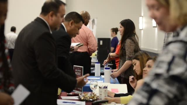 the choice career fair was held at the norris conference center in san antonio texas on thursday april 16 2015 shots job applicants speak to... - unemployment application stock videos & royalty-free footage