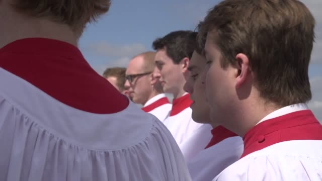 the choir of st john's college, cambridge, perform the ascension day carol from the top of the chapel tower at st john's college. every year on... - carol singer stock videos & royalty-free footage