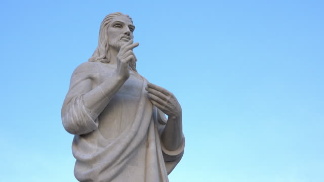 the christ of havana, a white marble sculpture on the shore of the city entrance, cuba - madera material stock videos and b-roll footage