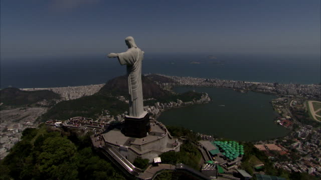 The Christ the Redeemer statue on top of Sugar Loaf Mountain overlooking Rio de Janeiro. Available in HD.