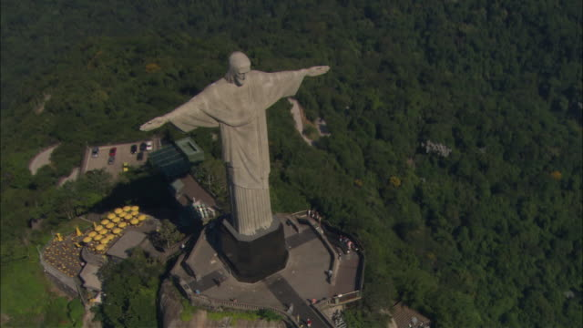 The Christ the Redeemer statue overlooks the Rio de Janeiro landscape.