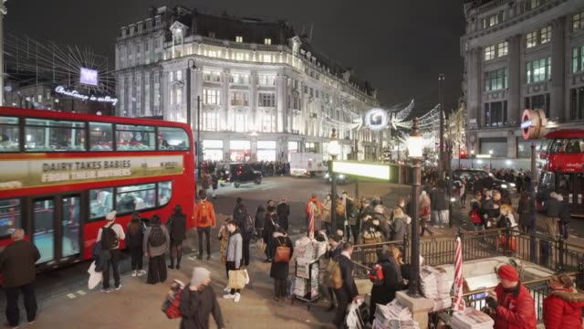 the christmas lights and crowds at oxford circus, london - christmas stock videos & royalty-free footage