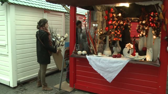 the christmas market in the french western city of nantes reopens a day after a man ploughed into a crowd there injuring 10 people - nantes stock videos & royalty-free footage