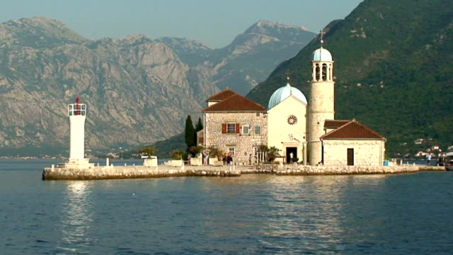 the church of our lady of the rock by boat in kotor bay, perast, montenegro - perast stock videos and b-roll footage