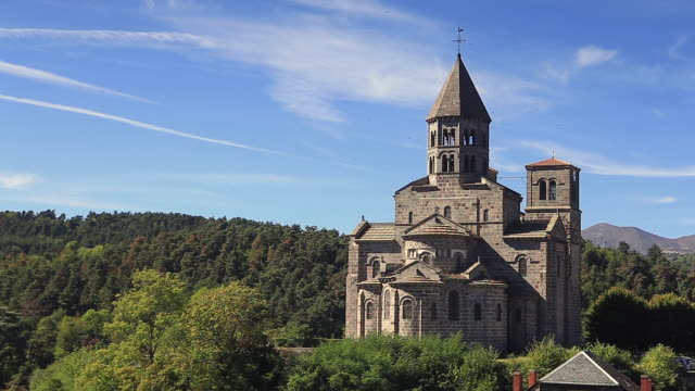 the church of saint nectaire in auvergne, france. - bell tower tower stock videos and b-roll footage