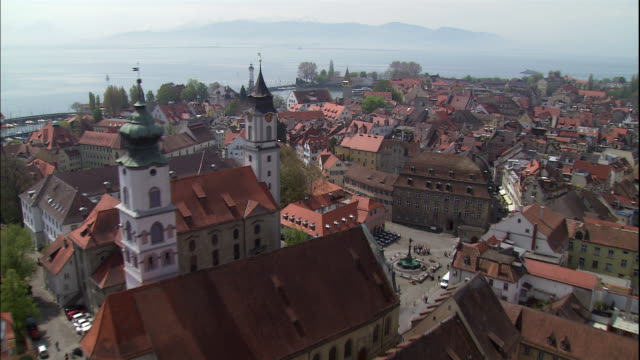 the church of saint stephan and unserer lieben frau cathedral tower in lindau, germany. - frau stock videos & royalty-free footage