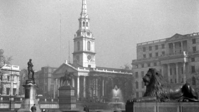 the church spire of st. martin's-in-the-fields towers above london's trafalgar square. - 1936 stock videos & royalty-free footage