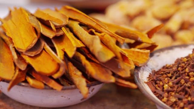 the cinnamon and dried clove buds in khari baoli market, delhi, india - cinnamon stock videos & royalty-free footage