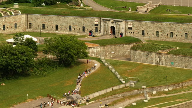 the citadelle of quebec, tourist group entering. aerial wide shot - spoonfilm stock-videos und b-roll-filmmaterial