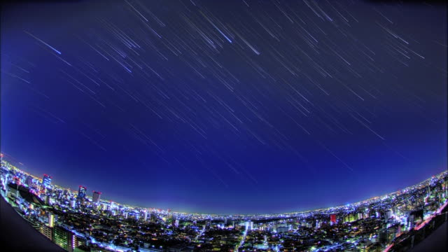 the city center; the night sky; the star trajectory: long shot; sfx; time lapse. - star trail stock videos & royalty-free footage