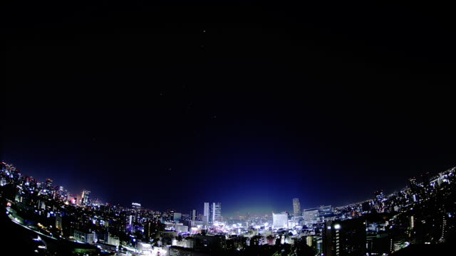 the city center; the night sky; the star trajectory: long shot; sfx; time lapse. - wide angle stock videos & royalty-free footage