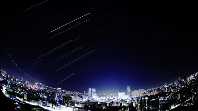the city center; the night sky; the star trajectory: long shot; sfx; time lapse. - 流星点の映像素材/bロール