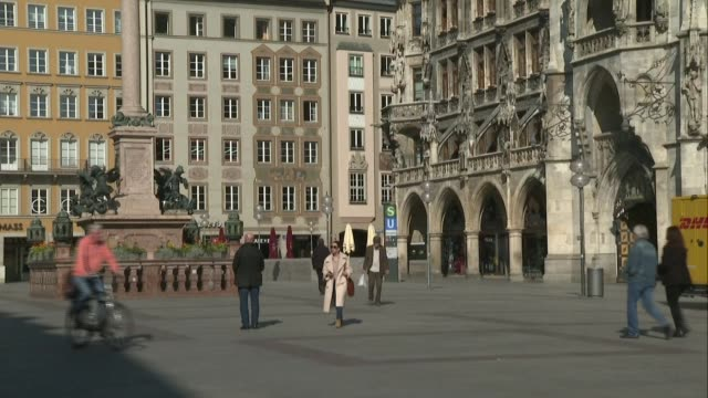 the city centre is less crowded than usual, but a few munich residents are still out on thursday, after german chancellor angela merkel once again... - baviera video stock e b–roll