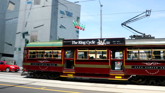 the city circle tram is seen as it passes federation square. shots of melbourne's iconic transport system taken on december 01, 2016 in melbourne,... - 路面軌道点の映像素材/bロール