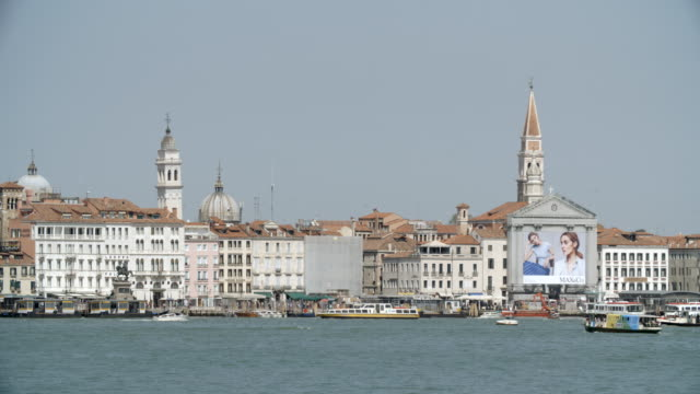 the city from the water / venice, italy - tabellone video stock e b–roll