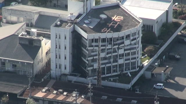 the city hall building in uto kumamoto prefecture is seriously damaged by the strong earthquake that hit the area early on april 16 2016 in uto japan - local government building stock videos & royalty-free footage