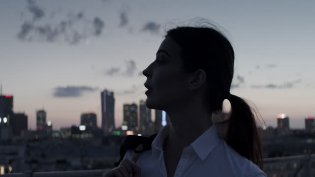 the city is mine. businesswoman relaxing on a rooftop - dark stock videos & royalty-free footage