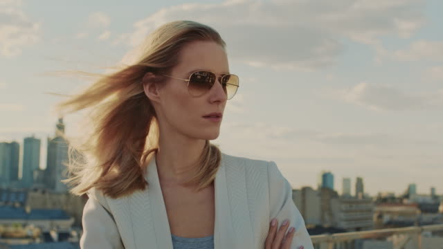 the city is mine. businesswoman standing on roof - eyewear stock videos & royalty-free footage