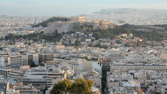 the city of athens with the acropolis in the distance, athens, greece, europe - athens greece stock videos & royalty-free footage