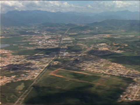 the city of florianopolis in brazil is seen from the air. - brasile meridionale video stock e b–roll