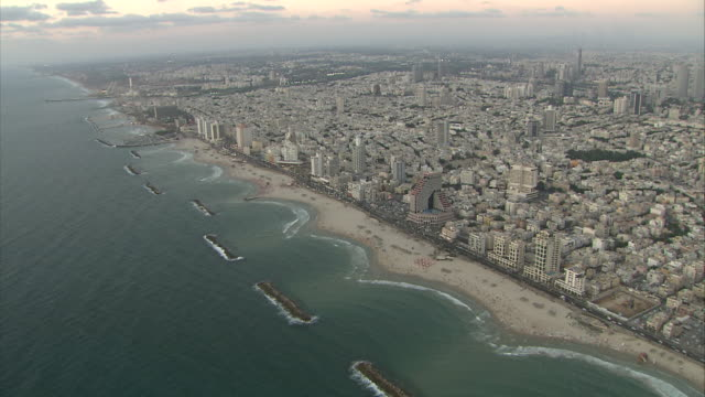 the city of haifa sprawls along the israeli coastline. - haifa video stock e b–roll