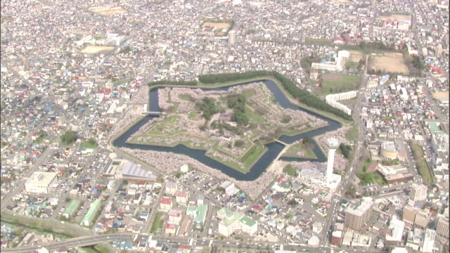 the city of hakodate surrounds goryokaku fort. - fortress stock videos & royalty-free footage