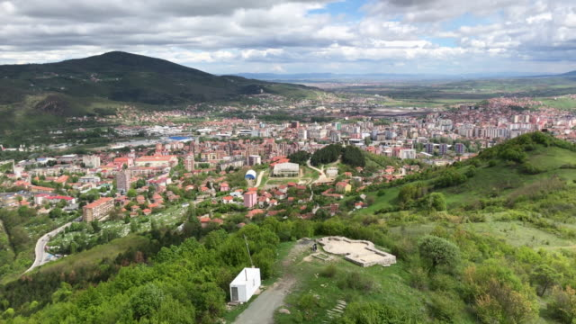 the city of mitrovica is seen from a hilltop from the majority ethnic-serb north on april 30, 2019 in mitrovica, kosovo. a recent eu-backed summit... - north stock videos & royalty-free footage