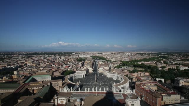the city of rome in italy is seen beyond st peters square from the roof of the basilica in vatican city on thursday june 25 2015 shots statues on the... - petersplatz stock-videos und b-roll-filmmaterial