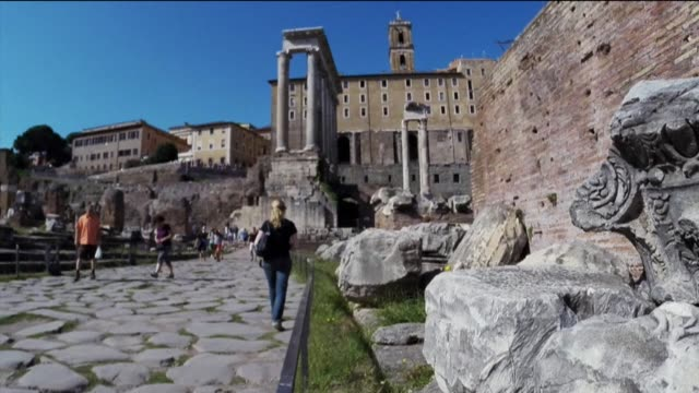 the city of rome restores ancient street as part of bimillennium of emperor augustus - archeologia video stock e b–roll