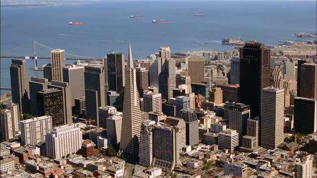 the city of san francisco rises above the bay. - san francisco california stock videos & royalty-free footage
