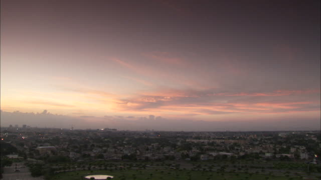 the city of santo domingo stretches across the horizon to the sea. available in hd - サントドミンゴ点の映像素材/bロール