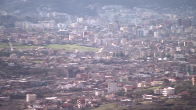 The city of Tirana sprawls across a valley. Available in HD.