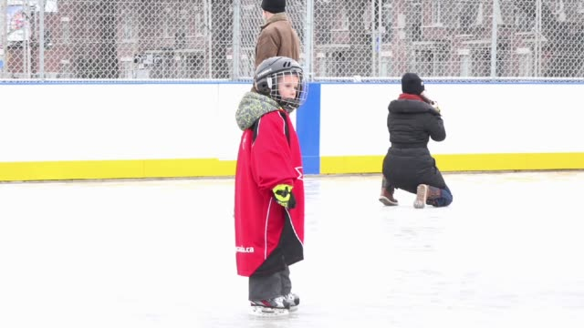The city of Toronto opens an ice rink for children in a Community Housing Neighborhood so they can skate and practice hockey the activities include...