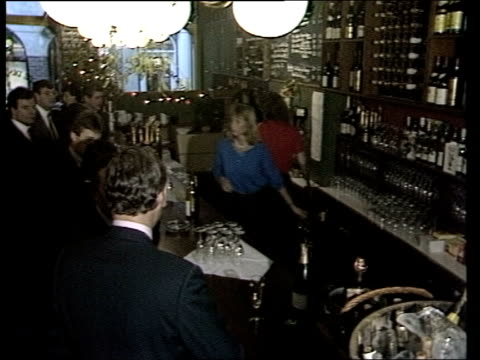 london the city tv set showing latest share prices pan rl city men drinking at bar to bv tcms hand pours champagne into glass ms side barman gives... - champagne stock videos & royalty-free footage