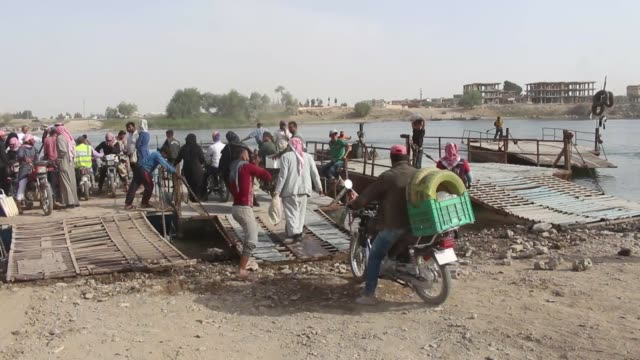 the civilians in ypg/pkk-held raqqah have been risking their lives to cross the euphrates river.the bridges, which link the city center with southern... - civilian stock videos & royalty-free footage